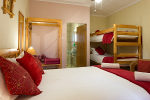 Room 4, a family room with double bed and double decker singles. en-suite with bath and shower
