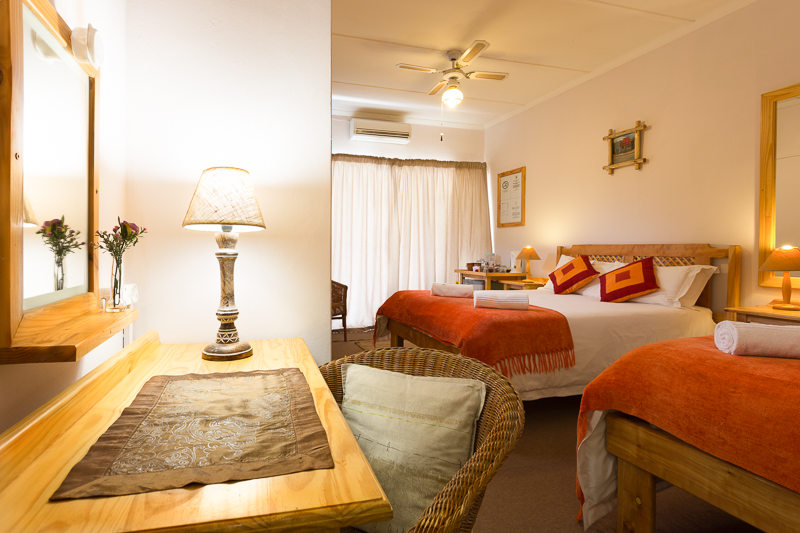 Room 2 sleeps three with a double bed and a single bed, with en-suite bathroom and shower