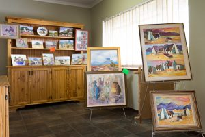 Browse through our local art for sale in the recption area