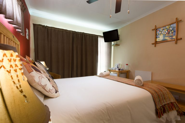 Our stylish Room 7 with queen-sized bed and en-suite bathroom with shower