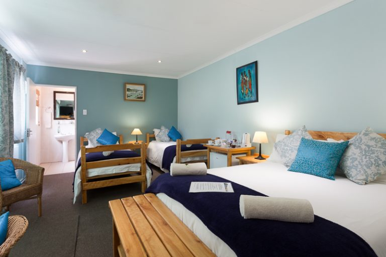 Our spacious Room 6 sleeps 4, with a double bed, 2 singles beds and en-suite bathroom with shower