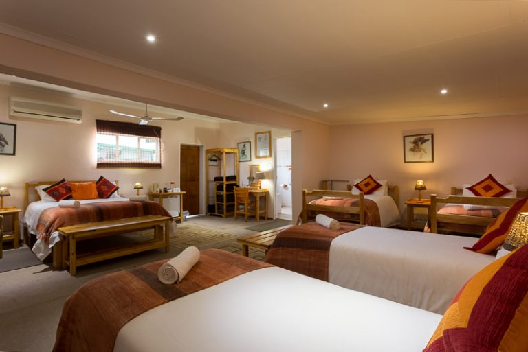 Sleeping 6 with a queen-sized bed and 4 single beds, en-suite with bath and shower, Room 5 is large!